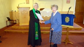 Sylvia Cook is presented with her 60 years Long Service Certificate